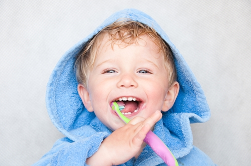 When should I teach my child how to floss?